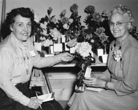 Mrs. L.E. Brooks and Mrs. J.L. Westerman compete in the Flower Show