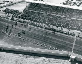 Aerial view of the Grandstand and horses on the track
